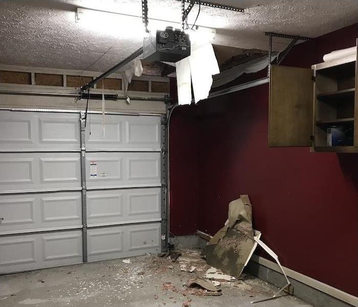 garage with ceiling damaged and falling down