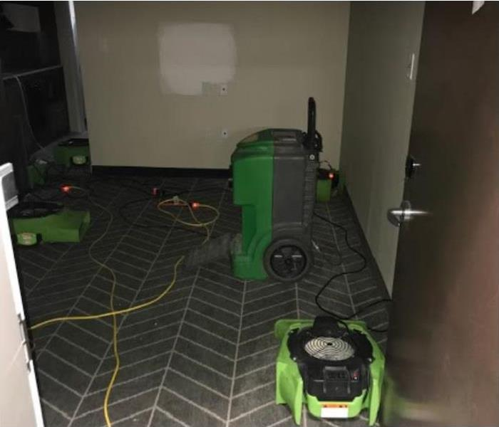 SERVPRO restoration equipment being used to dry carpet