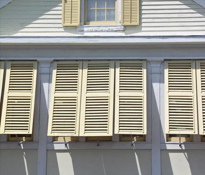 Storm Damage Using Storm Shutters to Prevent Flood Damage to Wilmington Homes