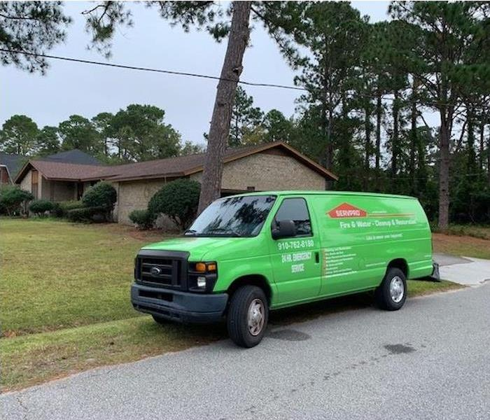 SERVPRO van parked outside of home